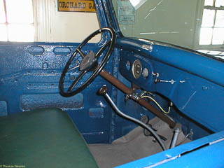 Interior of 1935 Ford pickup truck missing door panels