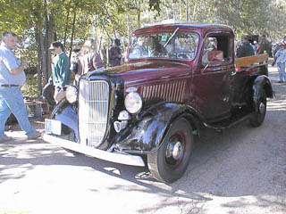 Maroon 1936 Ford pickup truck with black fenders