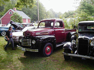 1948 Ford F-1 pickup truck, dark red with black fenders