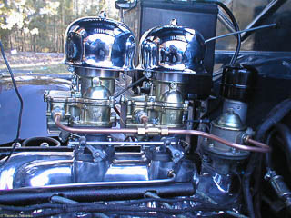 Freshly installed dual carburetors on Ford flathead V8