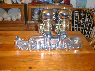 Polished aluminum intake manifold with two Stromberg 97 carburetors