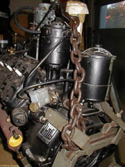 Rear of French flathead V8 showing oil filter, mechanical speed governor and revolution counter
