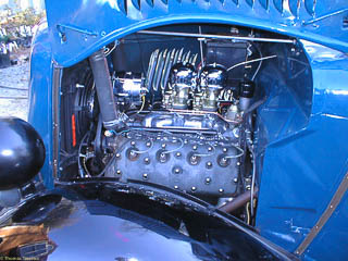 Engine compartment with freshly installed dual carburetors