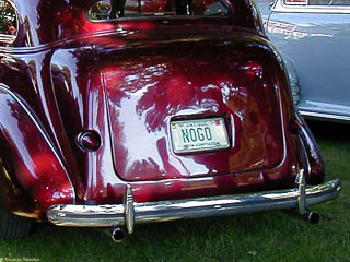 """NOGO"" license plate on the back of a nicely restored 1930's sedan"